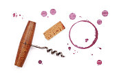 One red wine cork, corkscrew bottle opener, dry circle ring stain of glass and blob drops isolated on white background