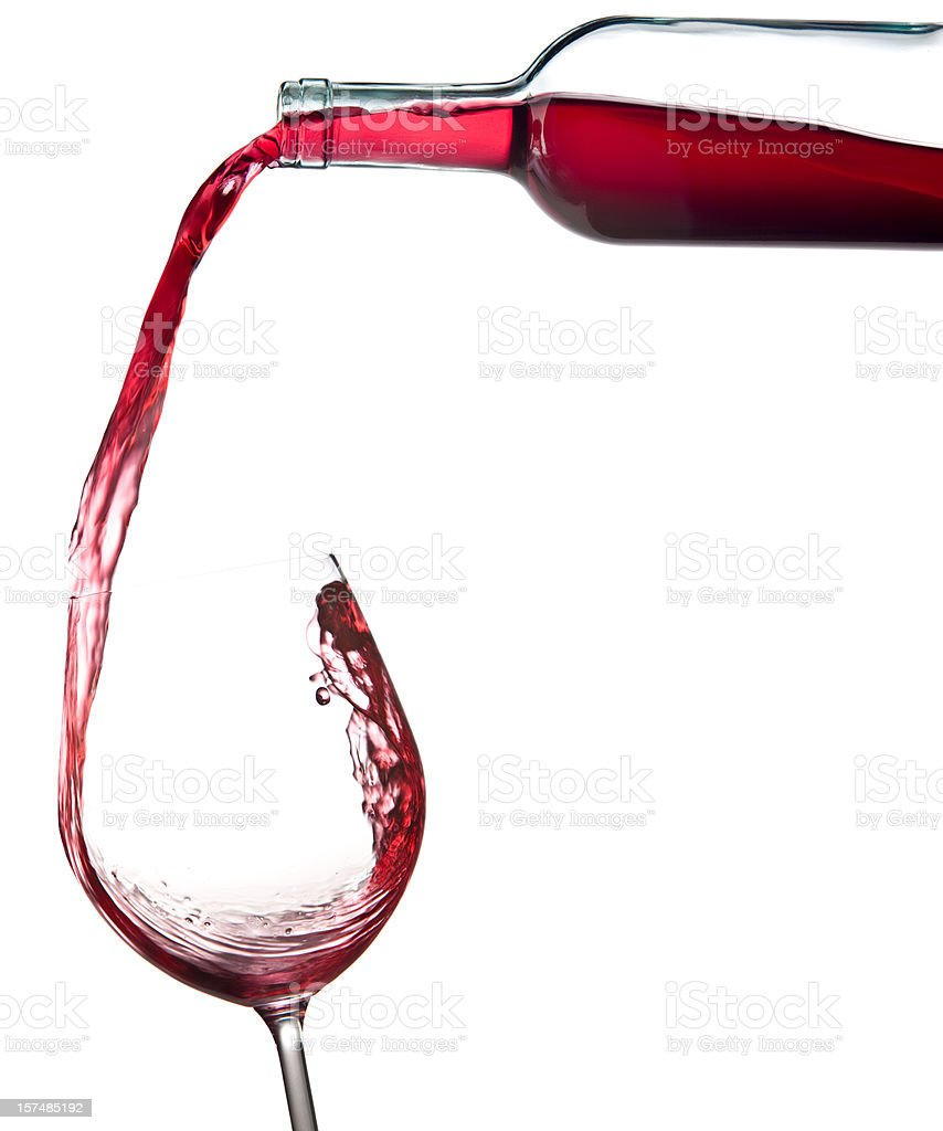 red wine falling from bottle to glass isolated on white royalty-free stock photo