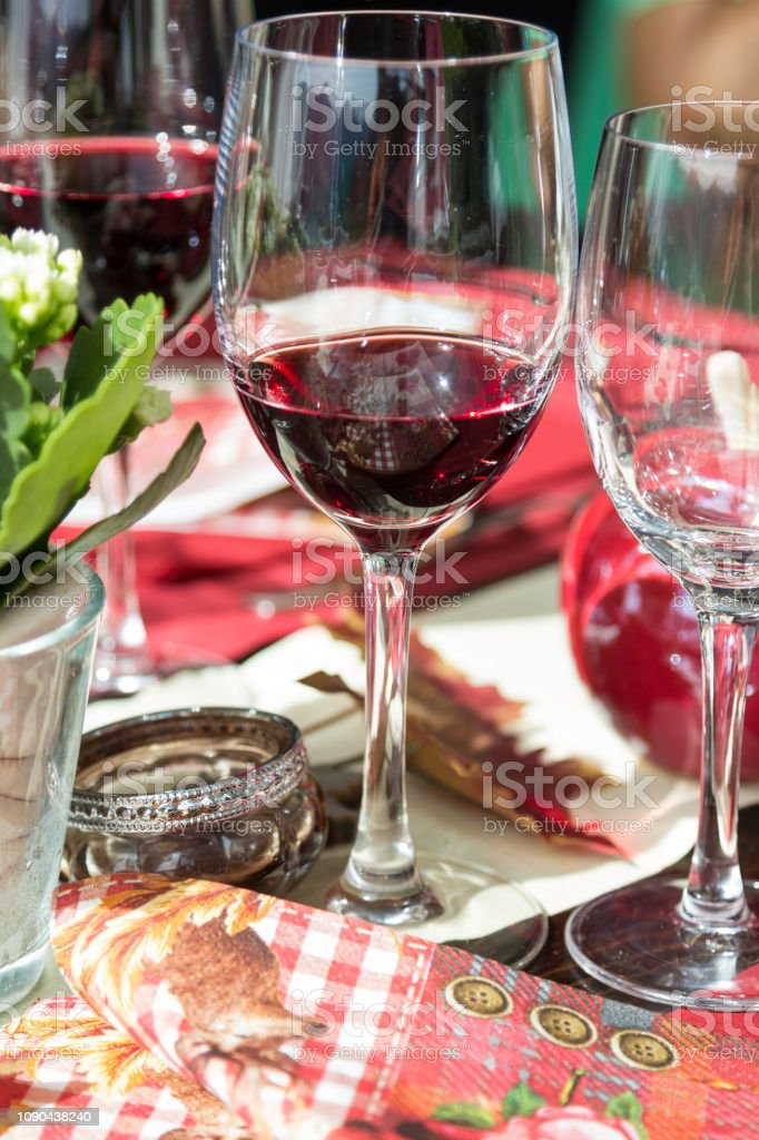 Red wine glass on the dining table in holiday and celebrating...