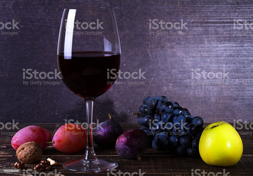 Red wine glass with fruits, cheese, figs and nuts royaltyfri bildbanksbilder
