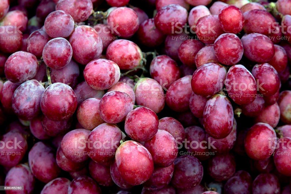 Red wine grapes background/ dark grapes, blue grapes , Red Grape, Cardinal Grape , Emperor Grape stock photo