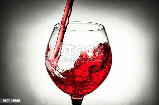 red wine in a glass splash