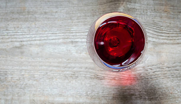 red wine in a wineglass. the top view - wine glass stock photos and pictures