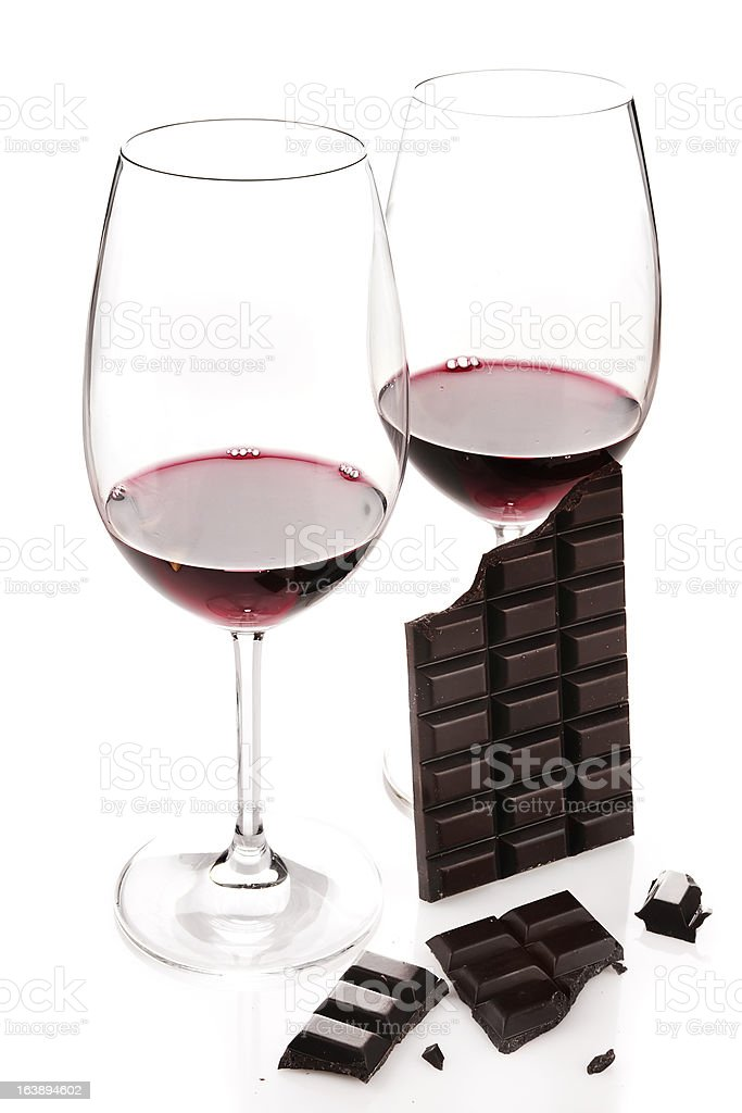 Red wine in glasses and dark chocolate isolated on white  royalty-free stock photo