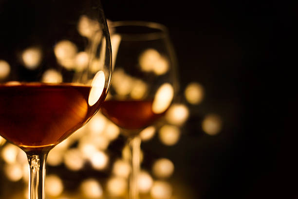 Red wine in two glasses with beautiful lights,black background Romantic, date, and Christmas image. table for two stock pictures, royalty-free photos & images