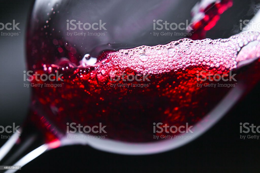 Red wine in wineglass stock photo