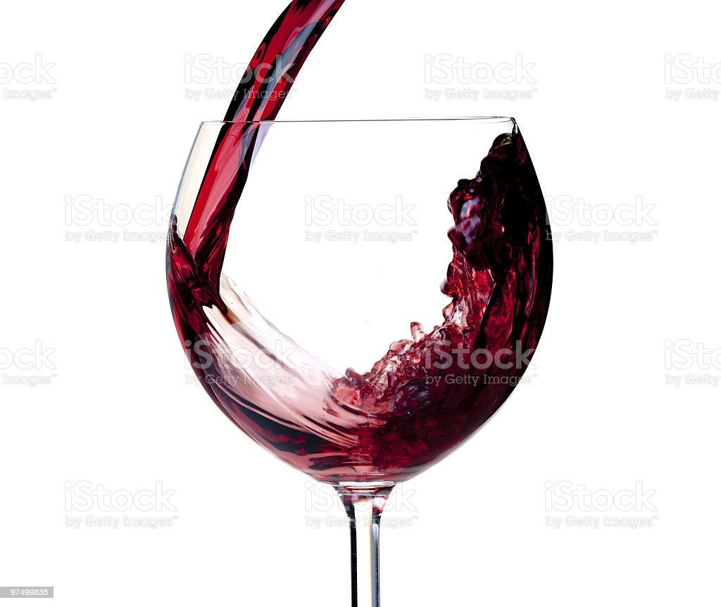 Red wine is poured into a glass royalty-free stock photo