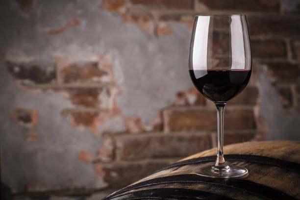 red wine on a barrel - moldova stock pictures, royalty-free photos & images