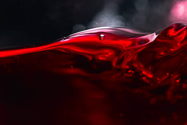 Red wine on black background Red wine on black background, abstract splashing. liquid stock pictures, royalty-free photos & images