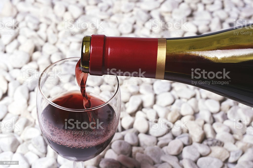 Red wine on the white stone. royalty-free stock photo
