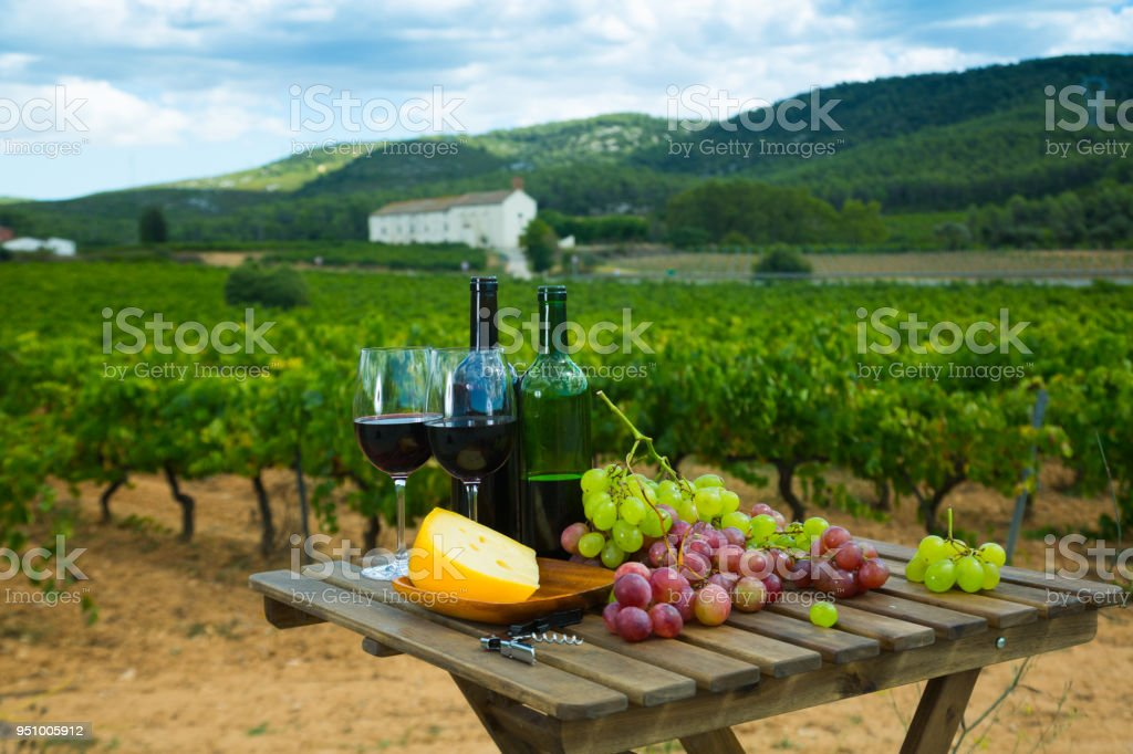 Red wine on wooden table with cheese stock photo