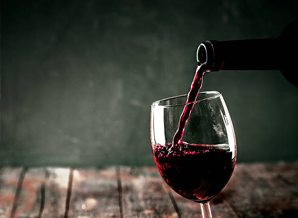 Red wine Red wine. Glass of wine. Pouring red wine. merlot grape stock pictures, royalty-free photos & images