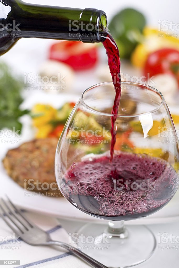 red wine poored from a bottle royalty-free stock photo