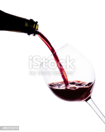 istock Red wine poring into wine glass. Close up. Isolated. 480225315
