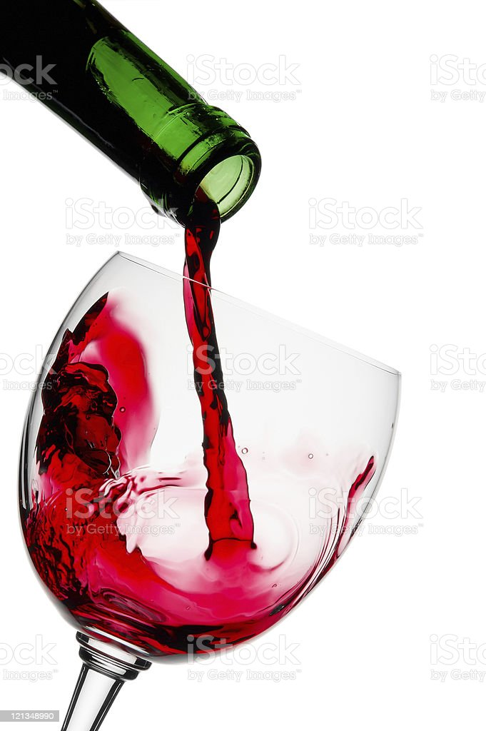 Red wine poured in a glass royalty-free stock photo