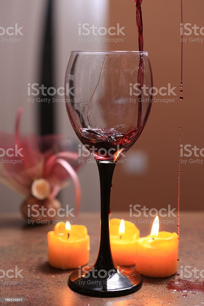 Red wine poured into glas royalty-free stock photo