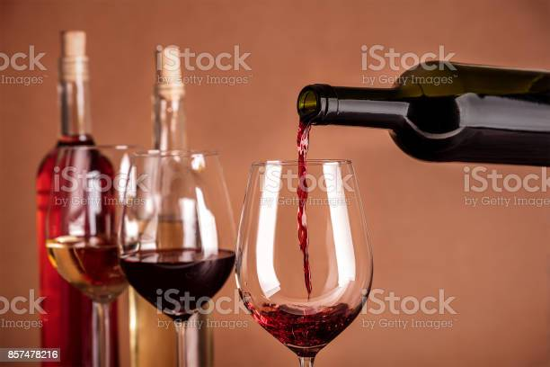 Red wine poured into glass from bottle with copyspace picture id857478216?b=1&k=6&m=857478216&s=612x612&h=hwbnubbzsyfllyrfnxww1gzqoxelwkg8lpcdxztubia=