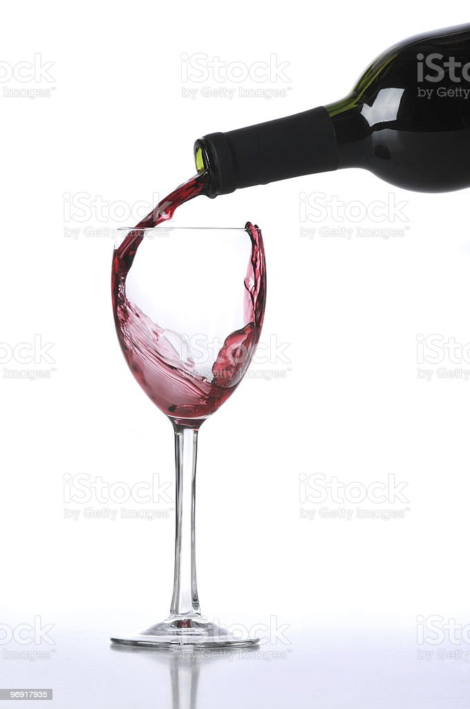 Red wine poured on glass royalty-free stock photo