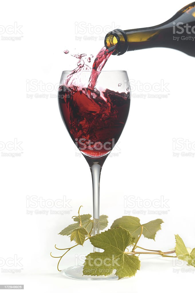 Red wine pouring into a glass. royalty-free stock photo