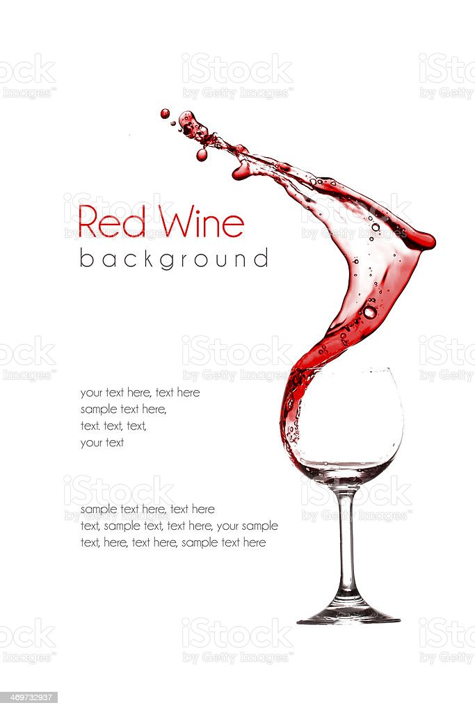 red wine pouring into wine glass isolated on a white background stock photo