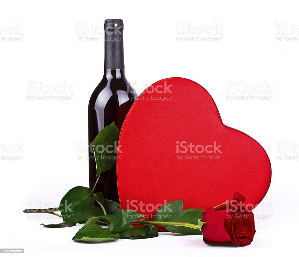 Red wine, rose and chocolate hearts royalty-free stock photo