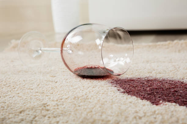 Red Wine Spilled From Glass On Carpet stock photo