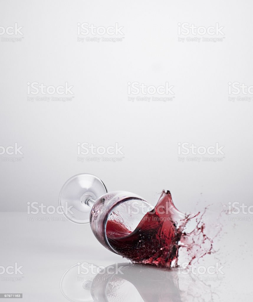 Red wine spilling from glass royalty-free stock photo