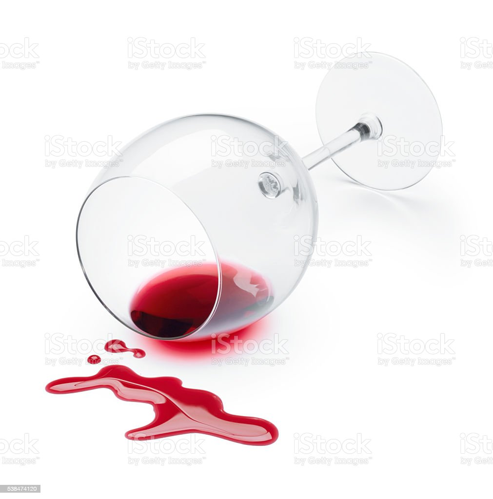 red wine spilling stock photo