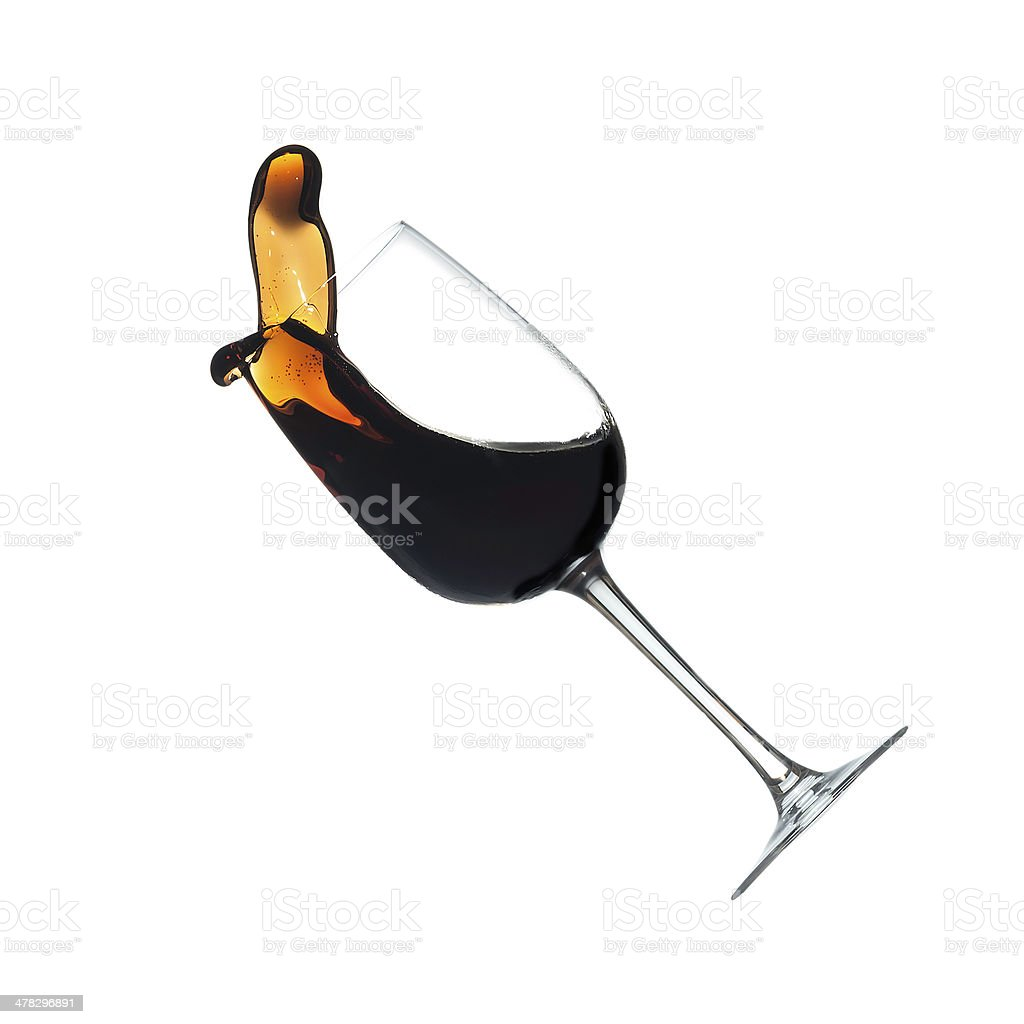 Red wine splashing from glass, isolated royalty-free stock photo