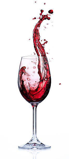 red wine splashing in glasses - wine glass stock photos and pictures