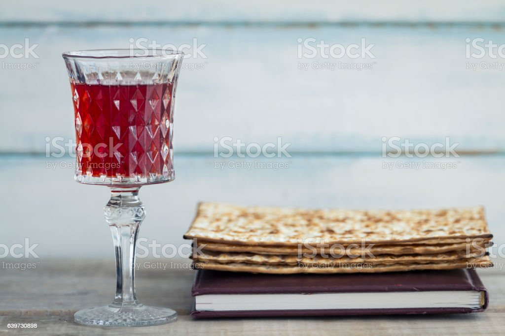 Red wine with a plate of matzah stock photo