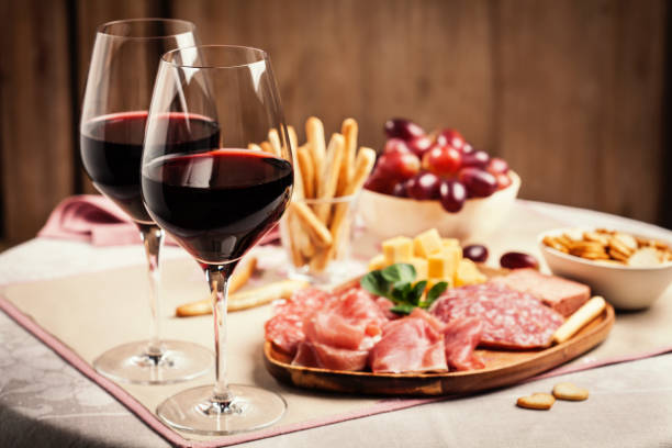 Red wine with charcuterie and cheese stock photo