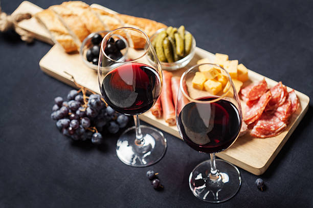 Red wine with charcuterie assortment on the background stock photo