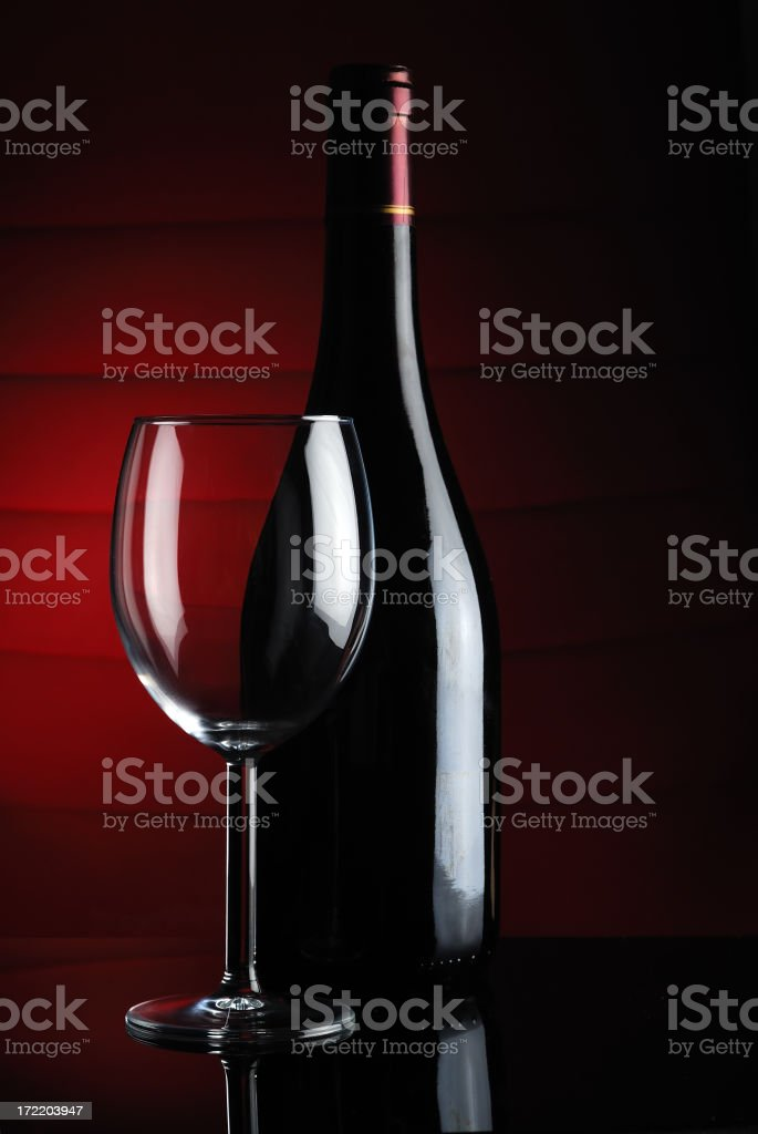 Red wine with empty glass royalty-free stock photo