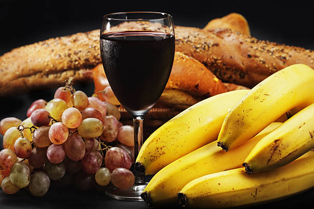 Red wine with fruits and pastry stock photo