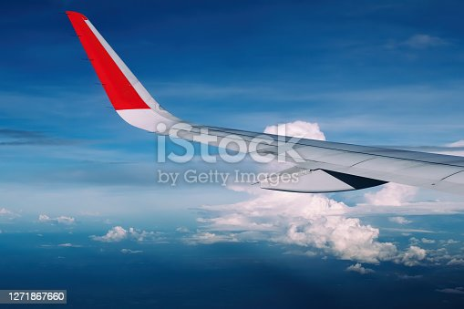 red winglet in graduated dark blue sky
