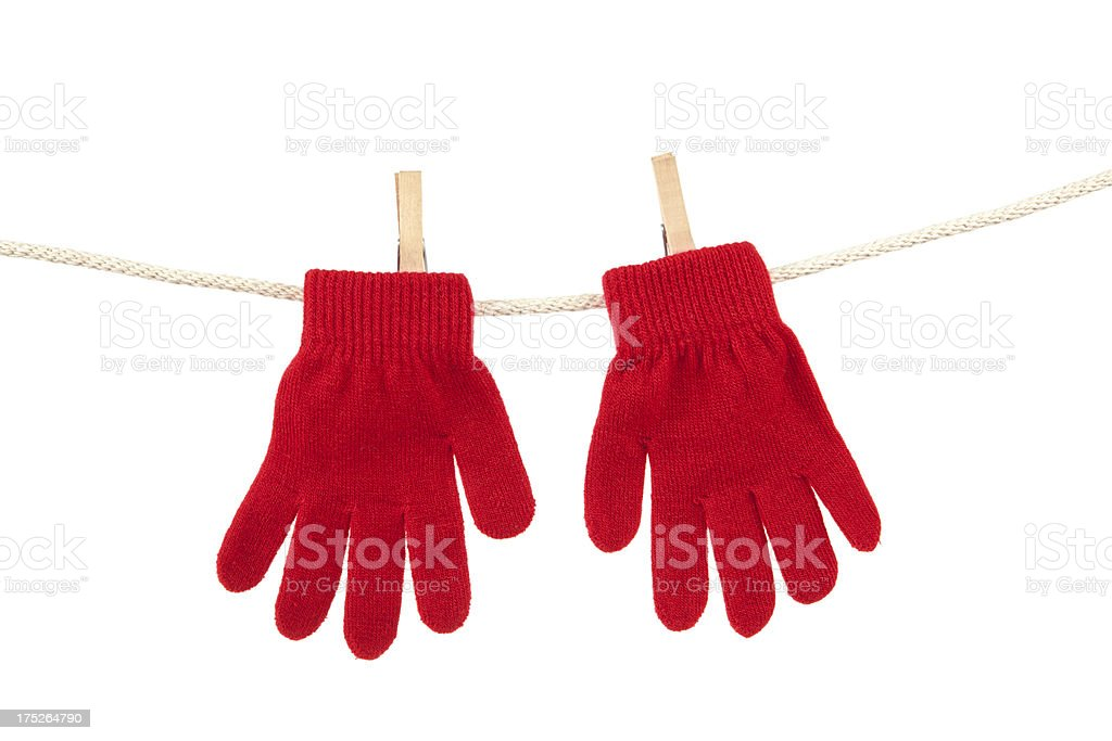 Red Winter Gloves on Clothesline. Studio Isolated stock photo