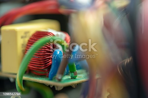 istock Red Wire Wound Toroid Inductor Closeup 1096547794