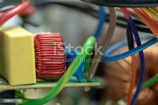 istock Red Wire Wound Toroid Inductor with Wires 1096547790
