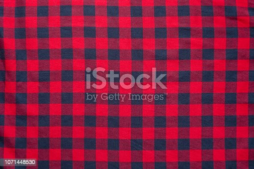 plaid material. Red dark blue cage clothes background