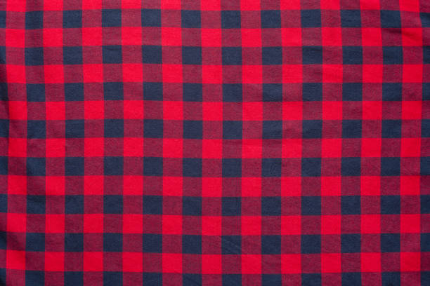 Red with dark blue color texture of checkered fabric plaid material. Red dark blue cage clothes background plaid stock pictures, royalty-free photos & images