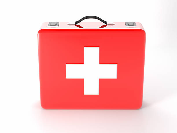 Red with white cross first aid kit on white background stock photo