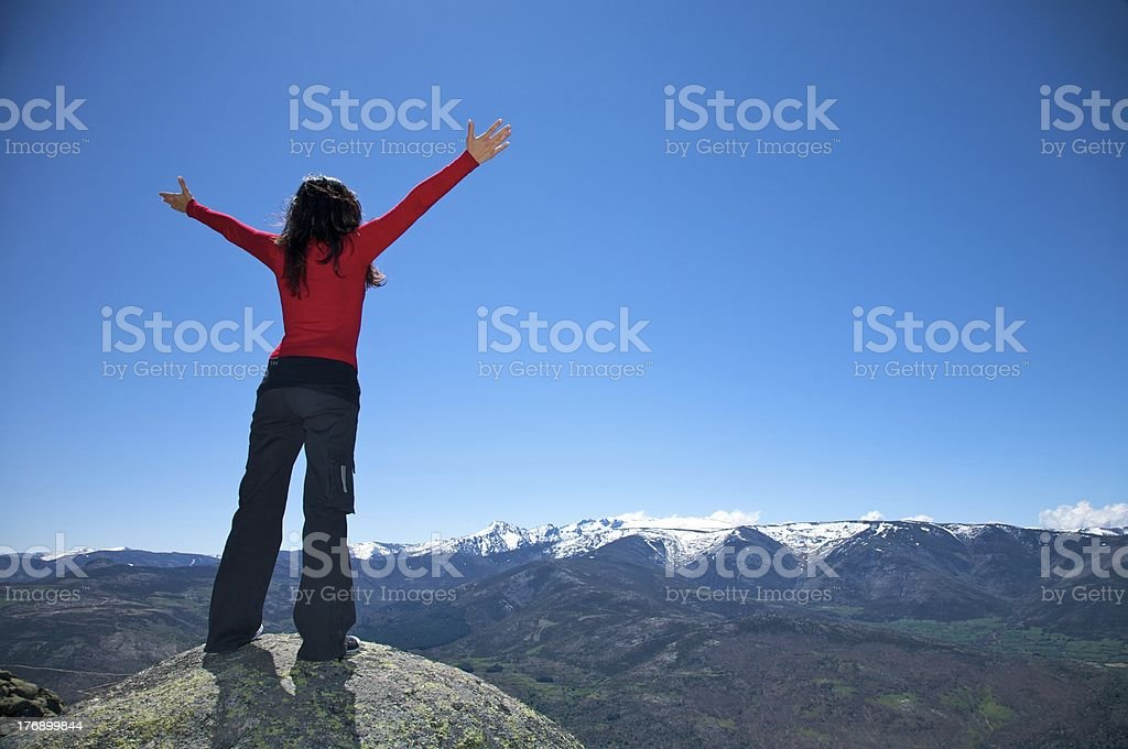 red woman greeting summit mountains peak and fly blue sky royalty-free stock photo