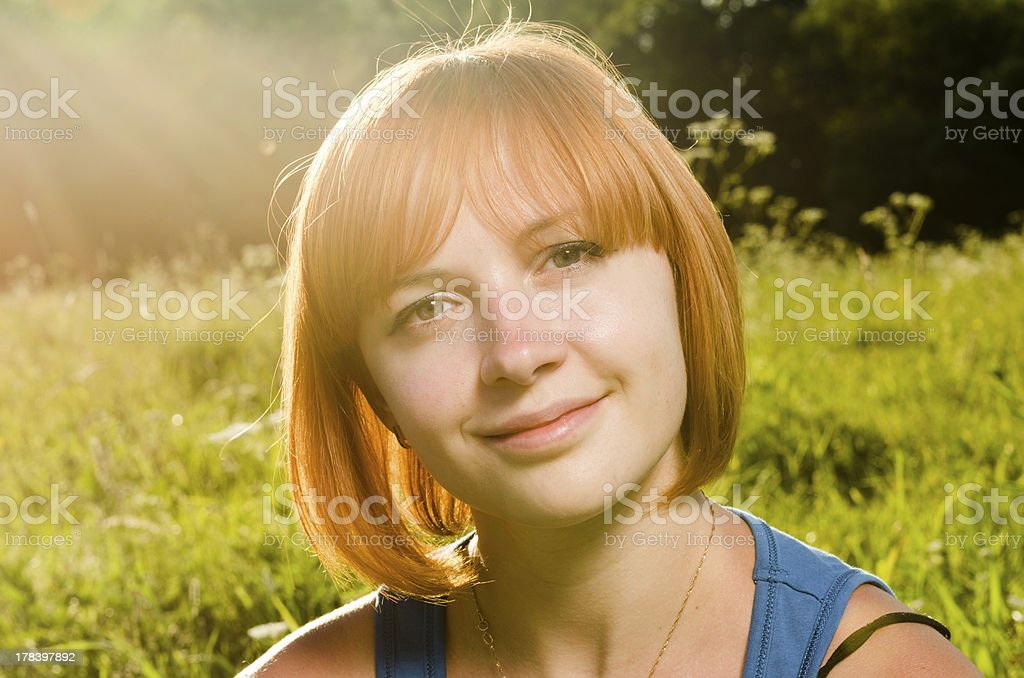 Red woman in warm sunshine stock photo