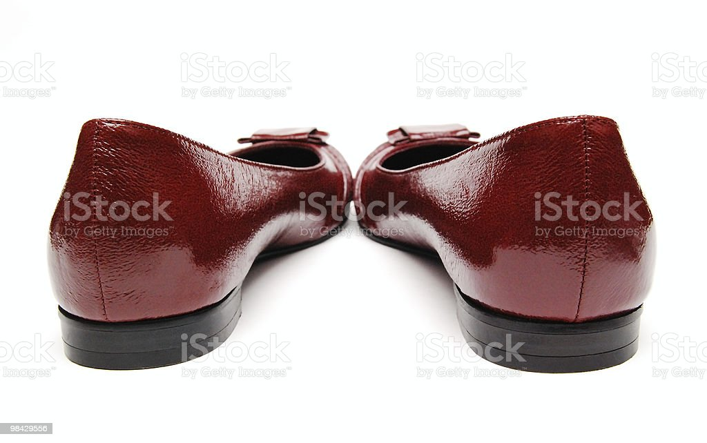 red womanish shoes on a white background royalty-free stock photo