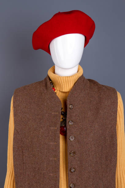 Red women beret and brown waistcoat. stock photo