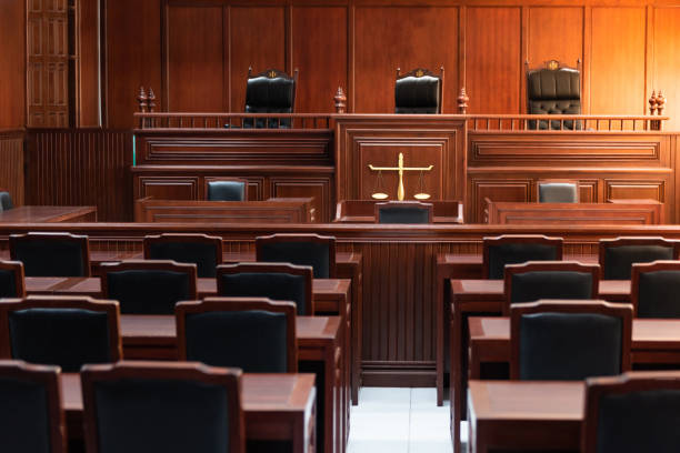 Red wood table and red chair in the justice court Red wood table and red chair in the justice court criminal stock pictures, royalty-free photos & images