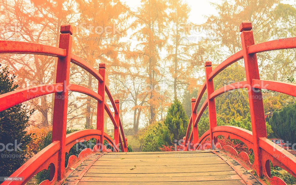 Red wooden bridge in soft light stock photo