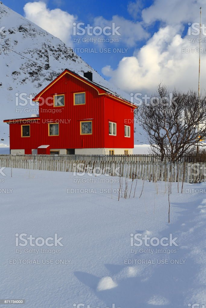 Red wooden cottage beside E10 European road. Vareid-Flakstadoya-Lofoten-Norway. 0529 stock photo