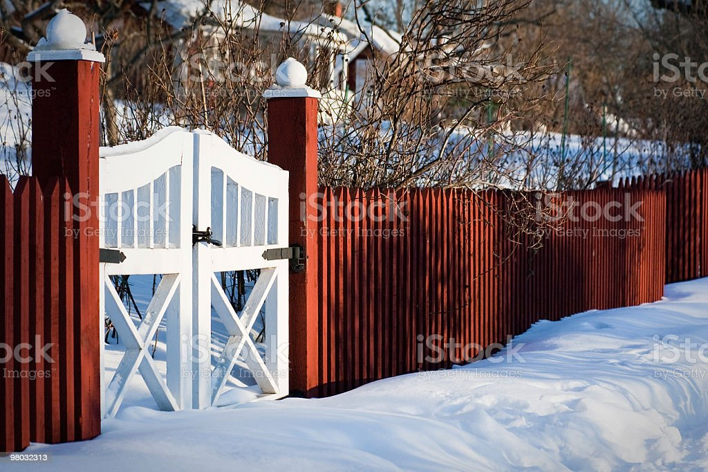 Red Wooden Fence in Winter royalty-free stock photo